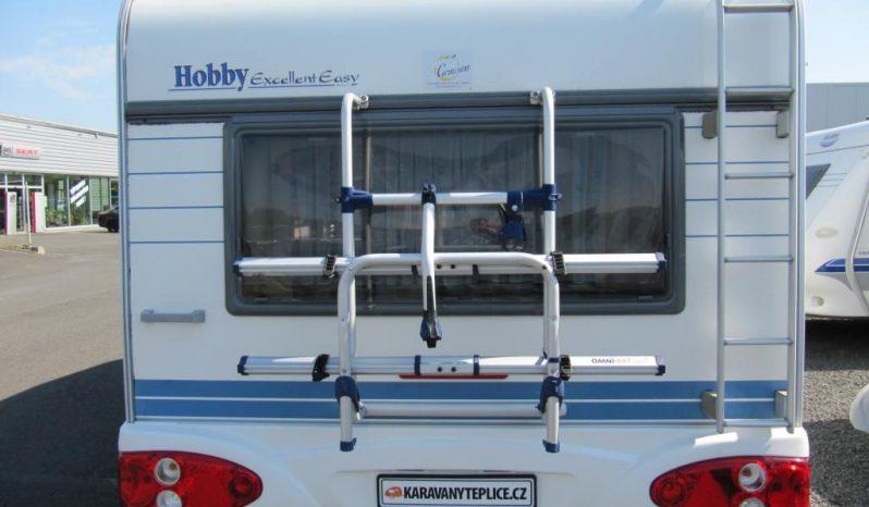 Hobby 495 UFE, model 2002 + kompletní před stan + zadní nosič kol + koberce do před stanu + hifi muzika plná